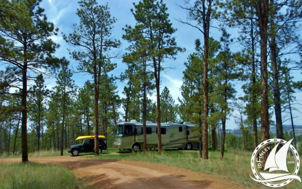 boondocking forest RV camping Montana Newmar Dutch Star