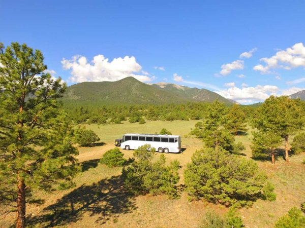 Missy Boondocking MCI 102 solar bus conversion coach forest colorado mountains